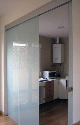 ejemplo de montaje de puerta de cristal corredera